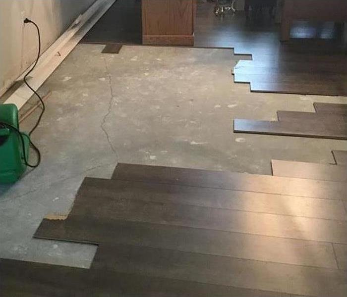 wood flooring removed for drying process