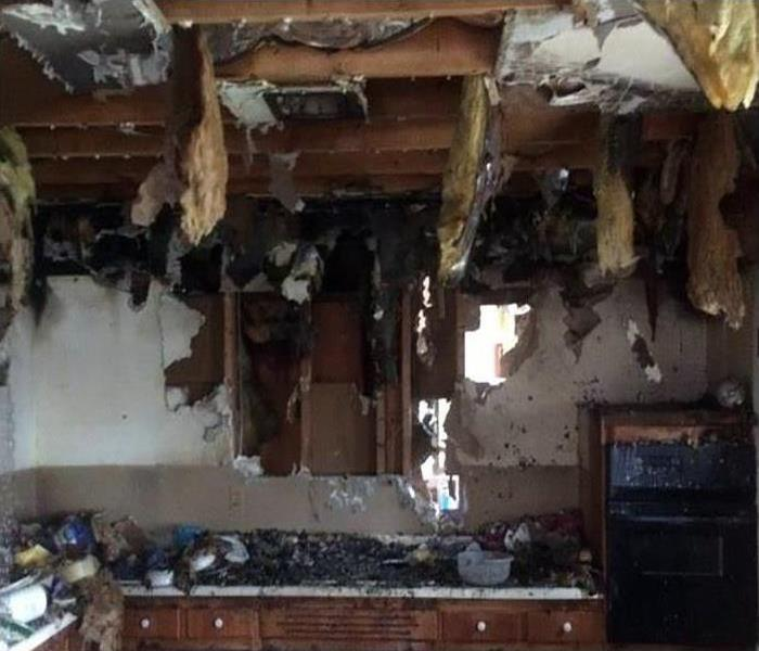 fire damaged kitchen with soot damage