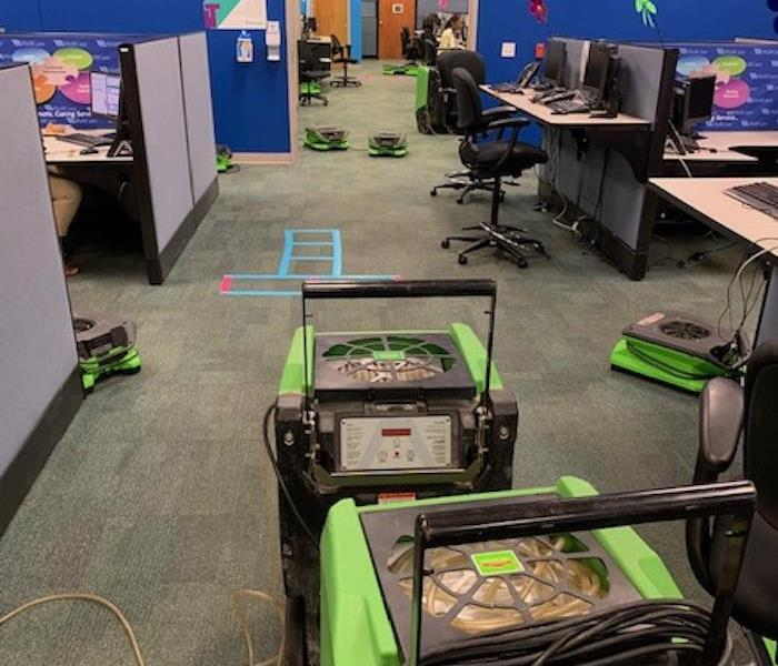SERVPRO drying equipment brought in to dry the carpet in a customer service center