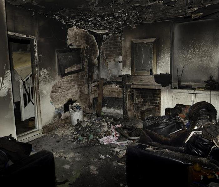 A room with fire damage and soot.