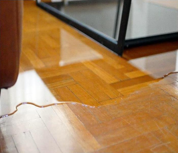 Close up of water flooding on room parquet floor